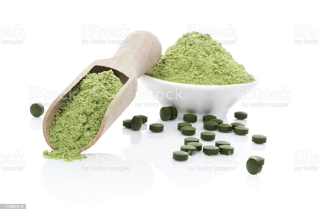 Wheatgrass powder and chlorella pills royalty-free stock photo