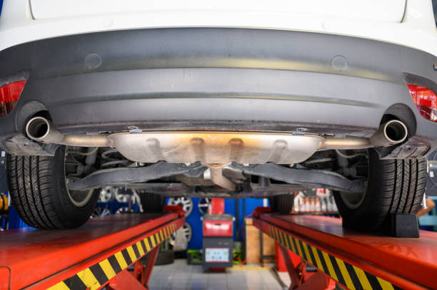 Wheel alignment, car on stand aligning for new tire replacement stock photo