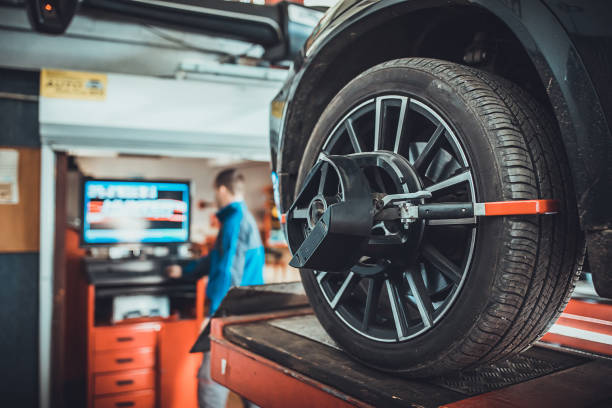 Wheel alignment equipment on a car wheel in a repair station stock photo