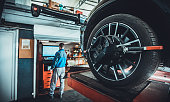 istock Wheel alignment equipment on a car wheel in a repair station 1227610166