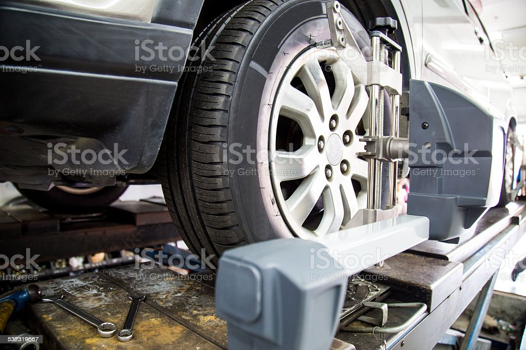 Wheel alignment of automobile stock photo