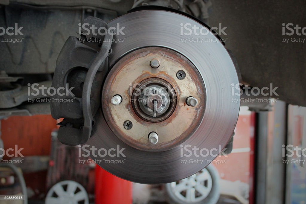 Wheel and disc break in maintenance process stock photo