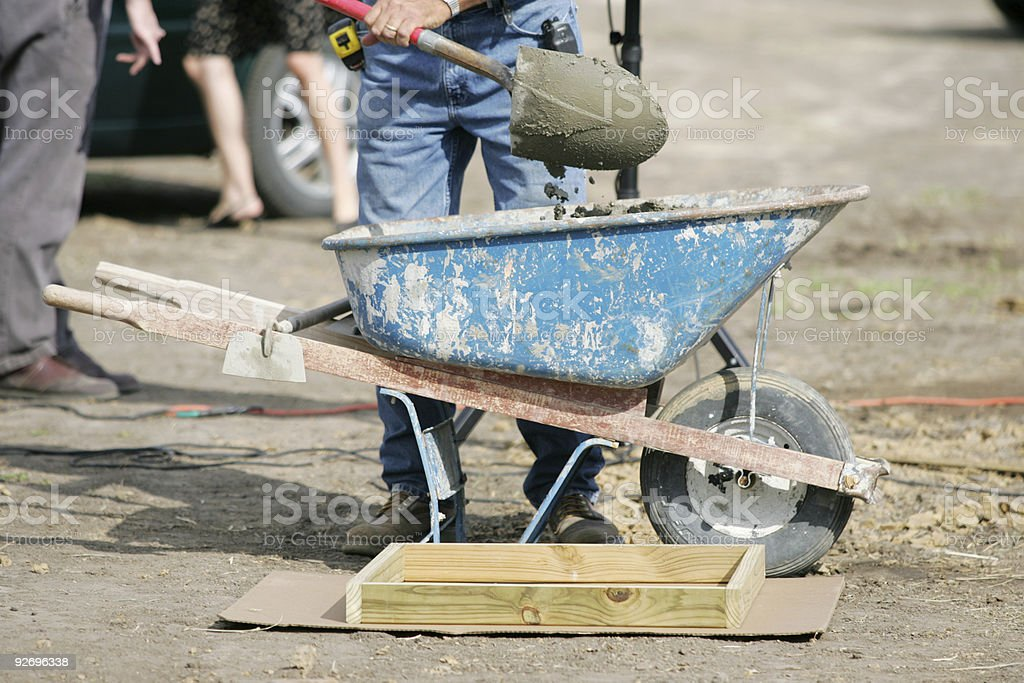 Wheel Barrel worker stock photo