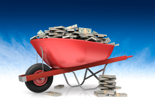 Wheel Barrow Full Of Money Stock Photo - Download Image Now