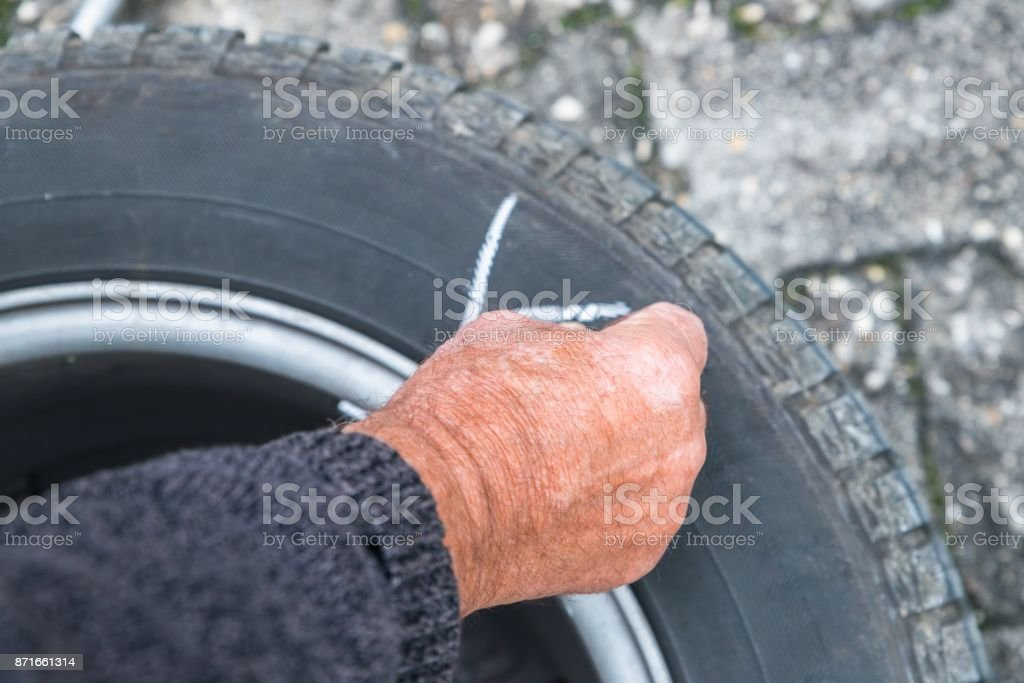Wheel change and label the tires with crayon stock photo