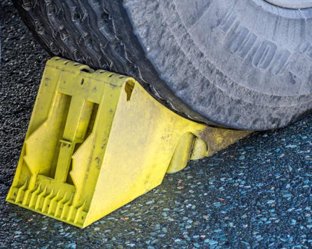 Wheel chock under a truck Wheel