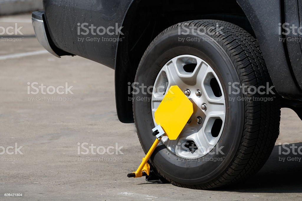 wheel clamp locked stock photo