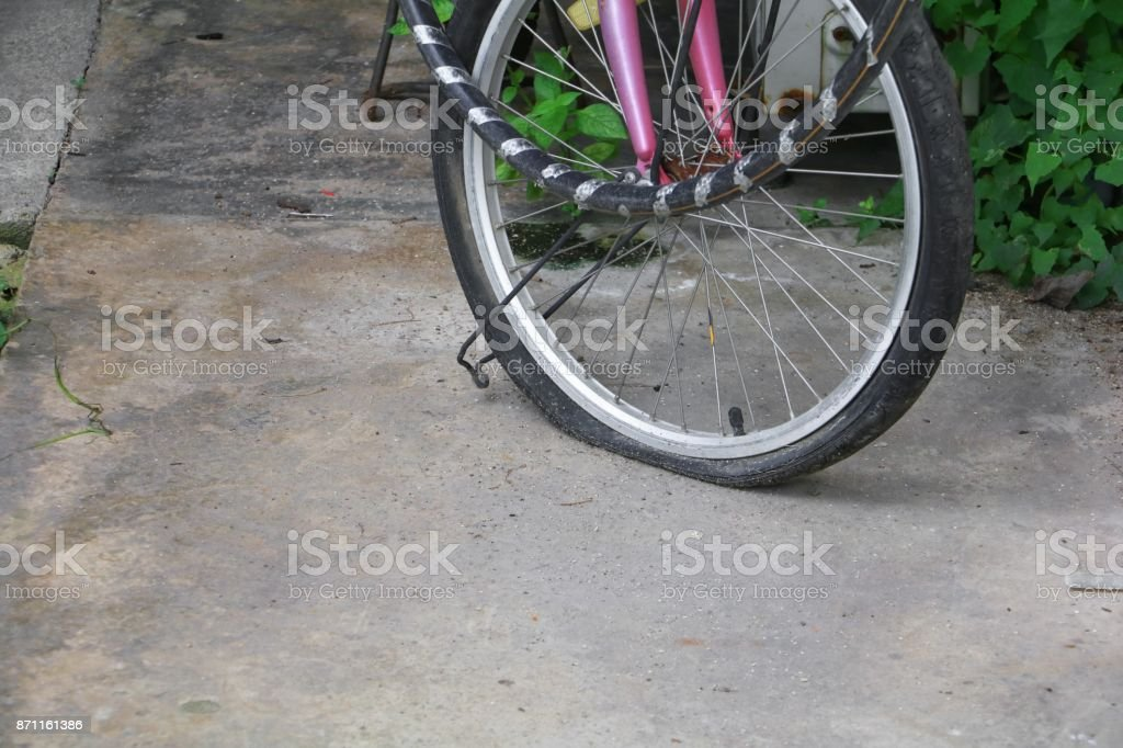 wheel flat tire of the bicycle old and cracked stock photo