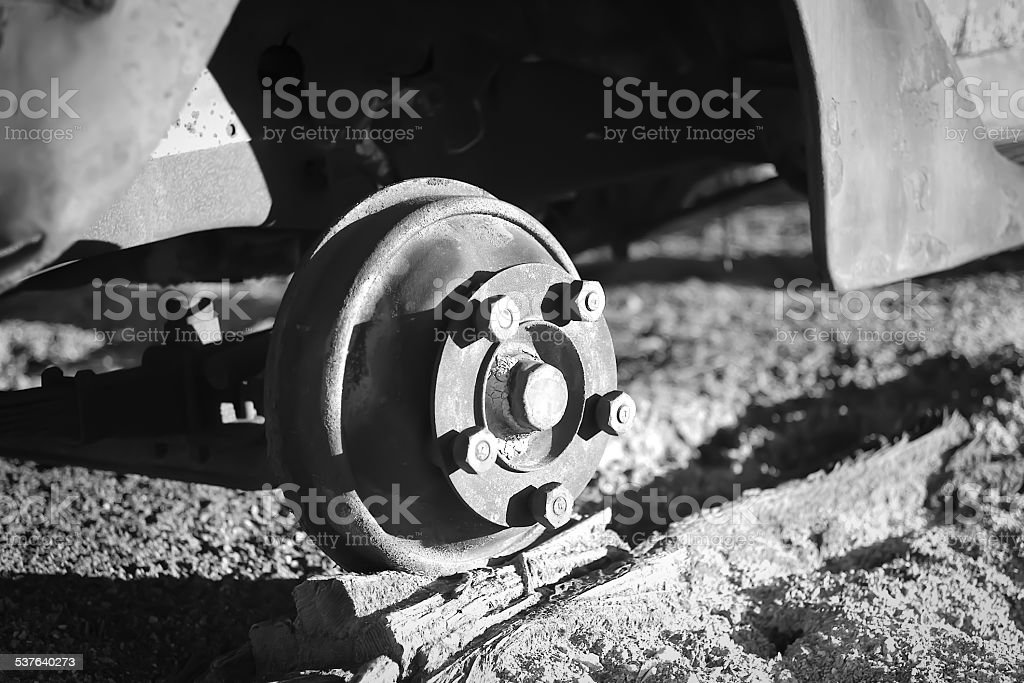 Wheel Hub missing tire, on blocks of wood in monochrome. stock photo