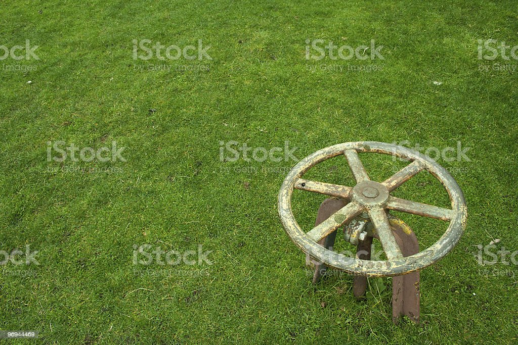 Wheel in grass royalty-free stock photo