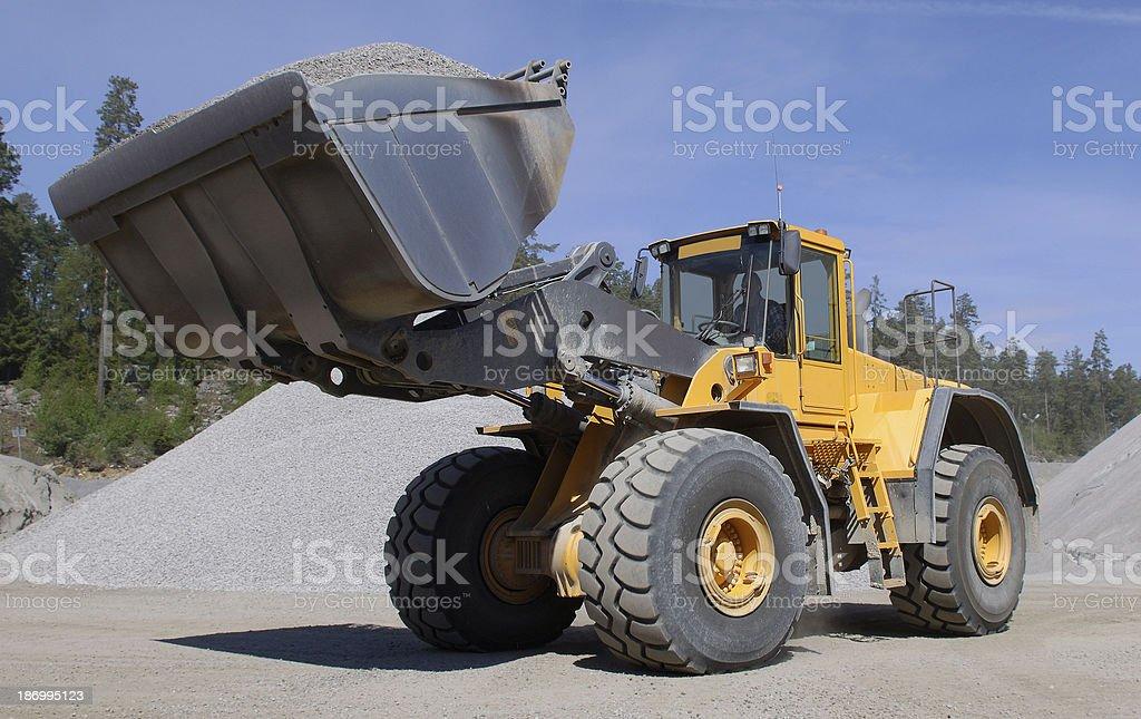 Wheel loader construction machine at work royalty-free stock photo