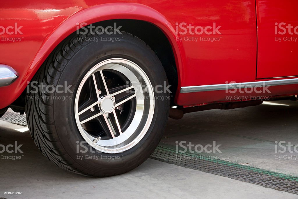Wheel of a red classic car. stock photo