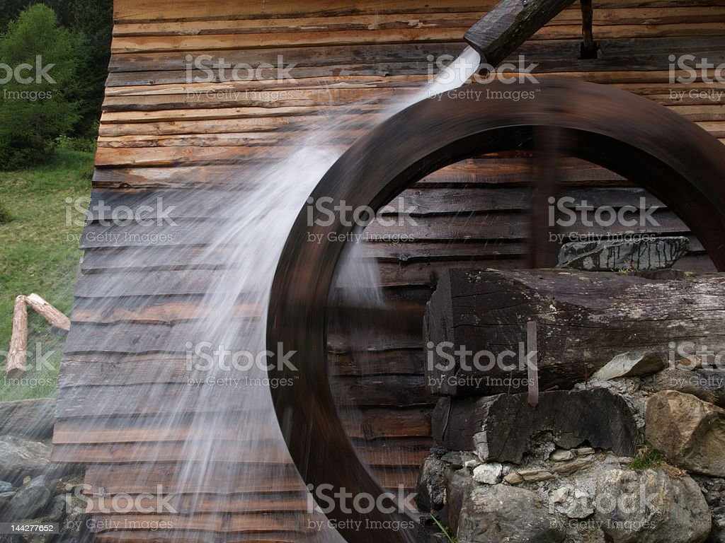 wheel of a watermill in South Tyrol stock photo