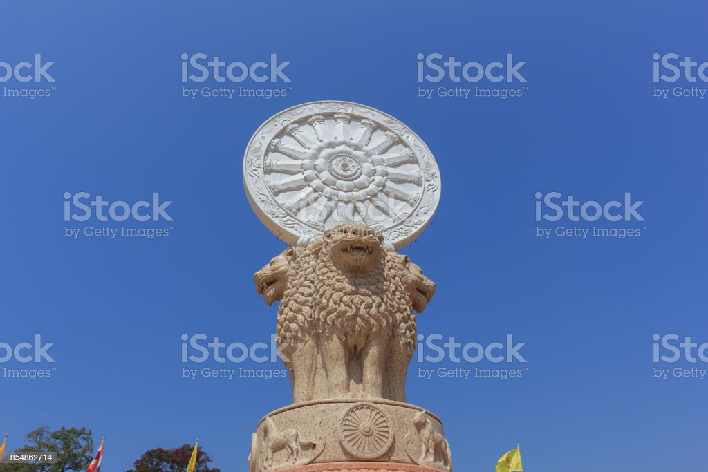 Wheel of Dhamma on lion statue in Thai temple. stock photo