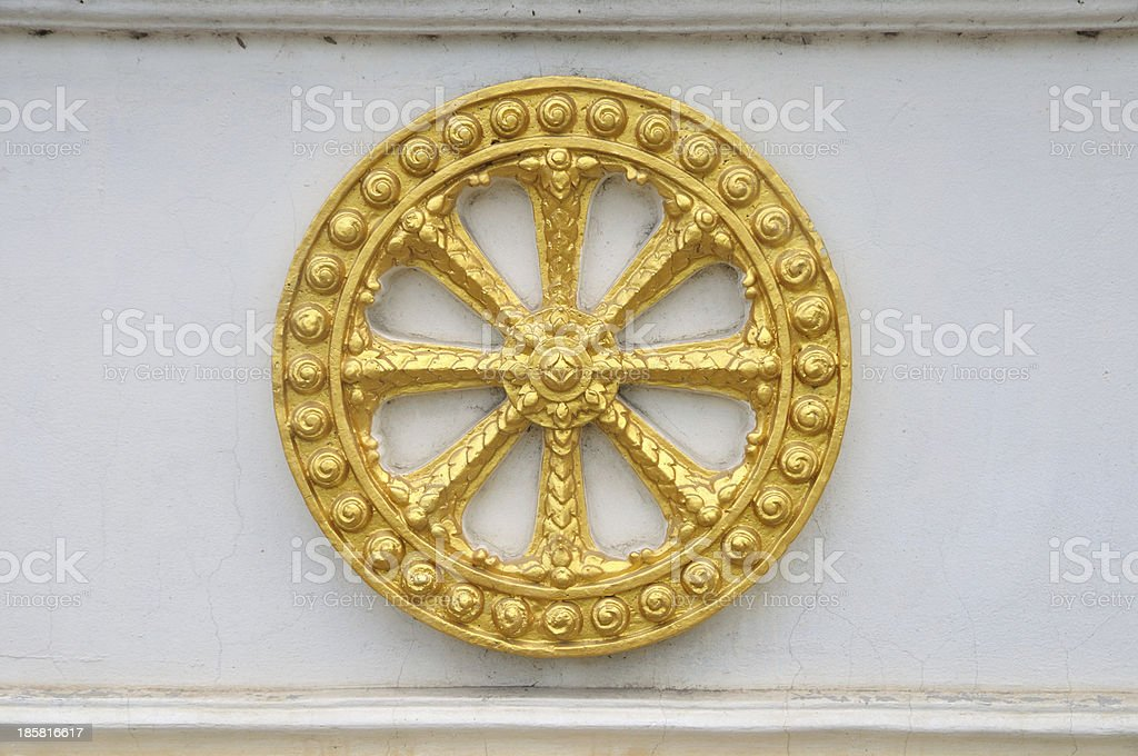Wheel of law, Dharma on the wall stock photo