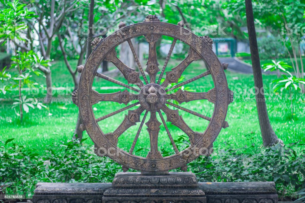 Wheel of life or Dharmachakra, Wheel of Dhamma stock photo