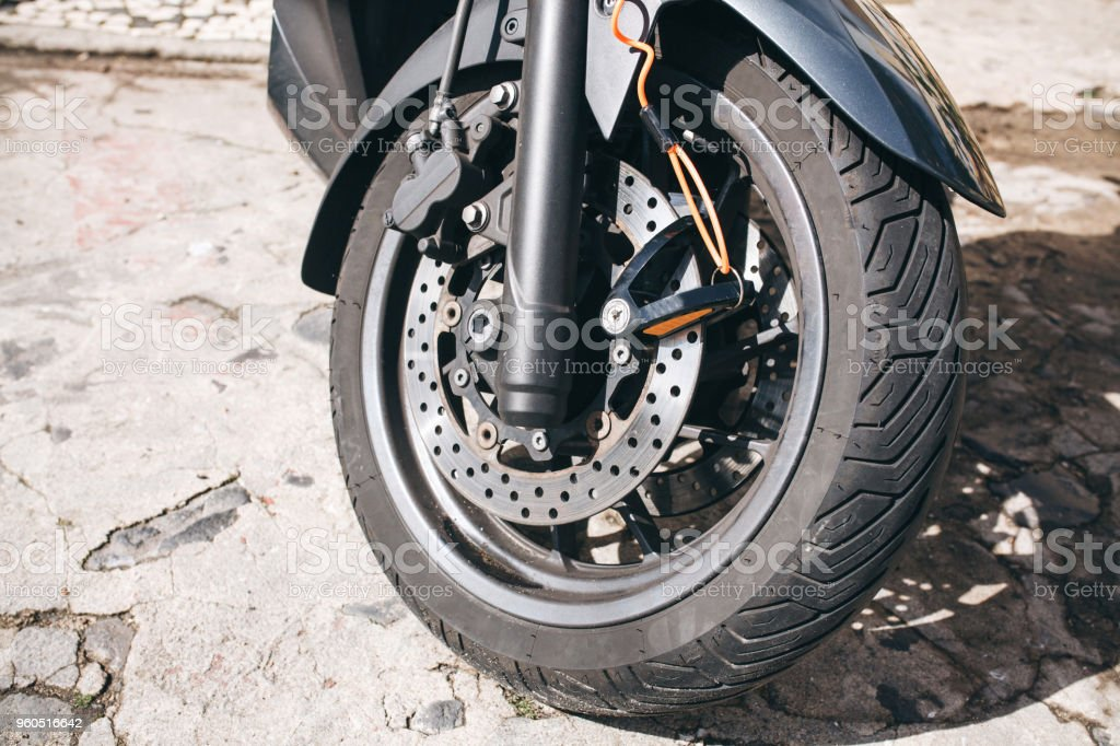 Wheel of motorcycle or scooter or moped. Autotire or tire and design...