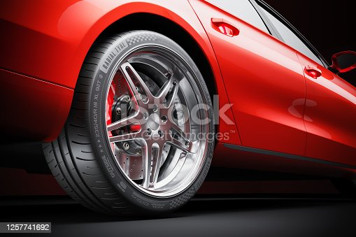 Wheel of red sports car closeup in studio lighting 3d render