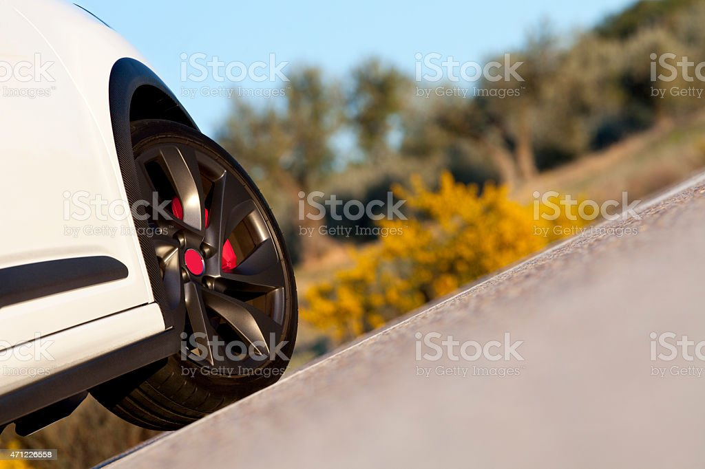 Wheel on a road. stock photo