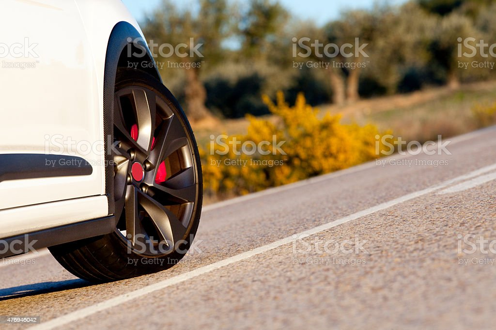 Wheel on a road stock photo