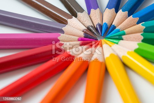 1137970382 istock photo Wheel pattern of colorful many colored pencils on a white background and copy space 1253860262