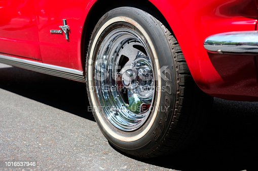 Berlin, Germany - june 09, 2018: Wheel rim / tire closeup of classic reed oldtimer Ford Mustang car
