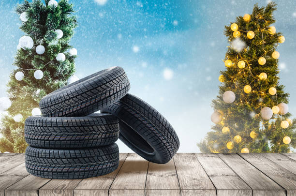 wheel rubber gift for Christmas on the wood textured backgrounds in a christmas interior stock photo