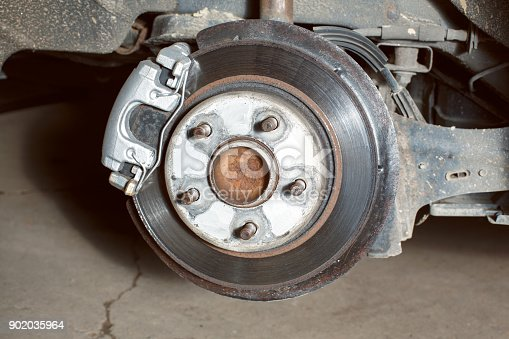 498888104 istock photo wheel suspension visible during  tire change 902035964