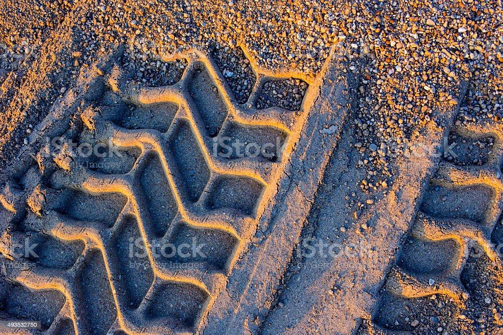 wheel track in sand stock photo