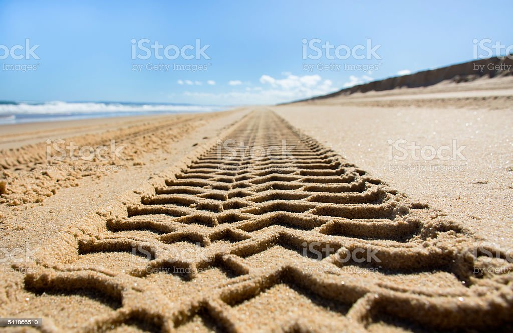 Wheel track on sand beach stock photo