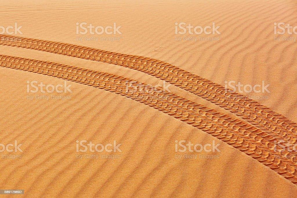 Wheel track on sand in the Sahara Desert stock photo