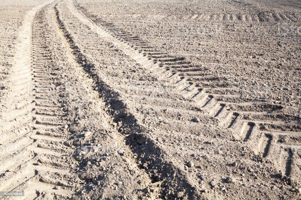 Wheel tracks on the ploughed field zbiór zdjęć royalty-free