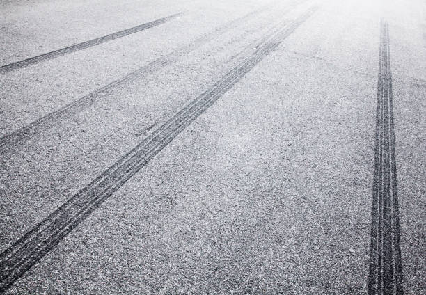 Wheel tracks on the road covered with hoarfrost Wheel tracks on the road covered with hoarfrost. tire track stock pictures, royalty-free photos & images
