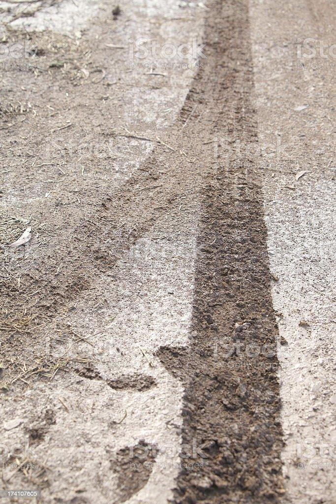 Wheel tracks on the road royalty-free stock photo