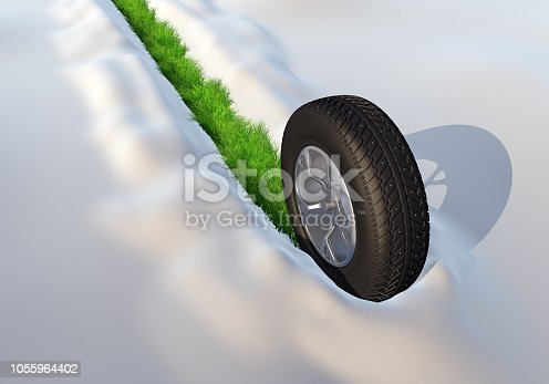 istock Wheel with Winter Tire Going through the Snow Leaving the Green Grass Track 1055964402