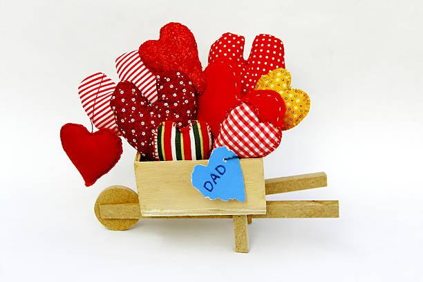 Wheelbarrow and hearts-shape. Father's Card Series. stock photo