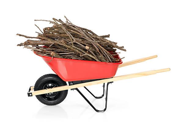 wheelbarrow full of branches - kruiwagen met gereedschap stockfoto's en -beelden