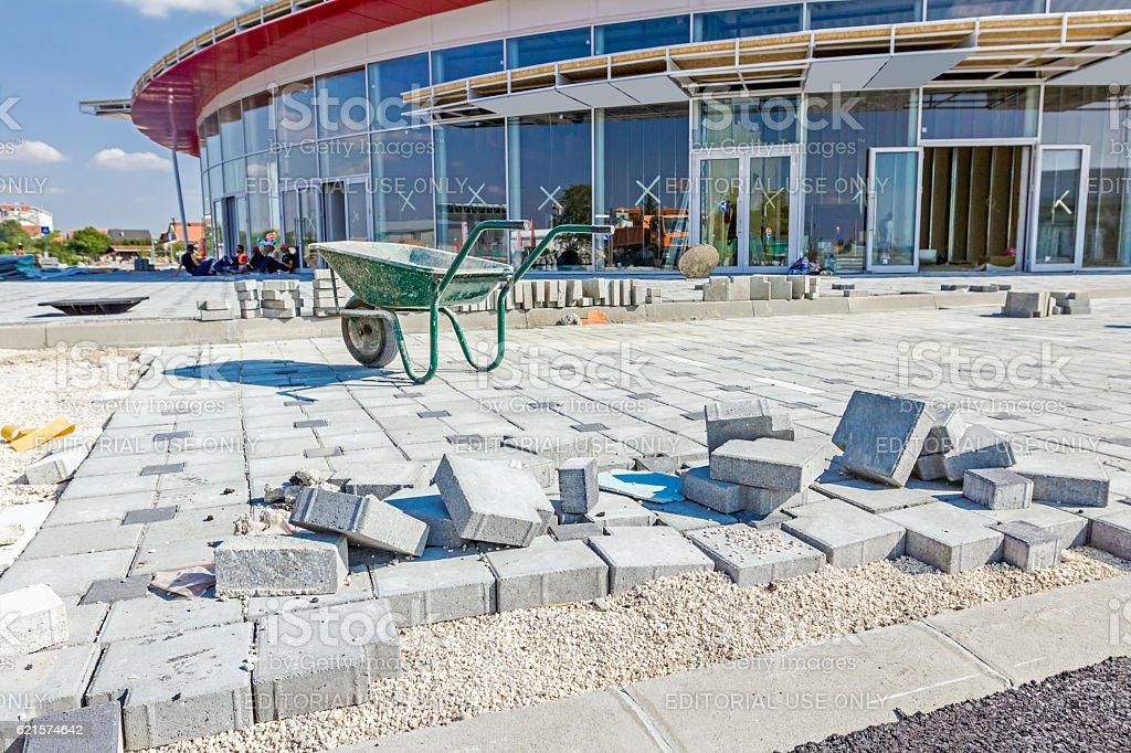 Wheelbarrow is on construction site. Landscape transform into ur photo libre de droits