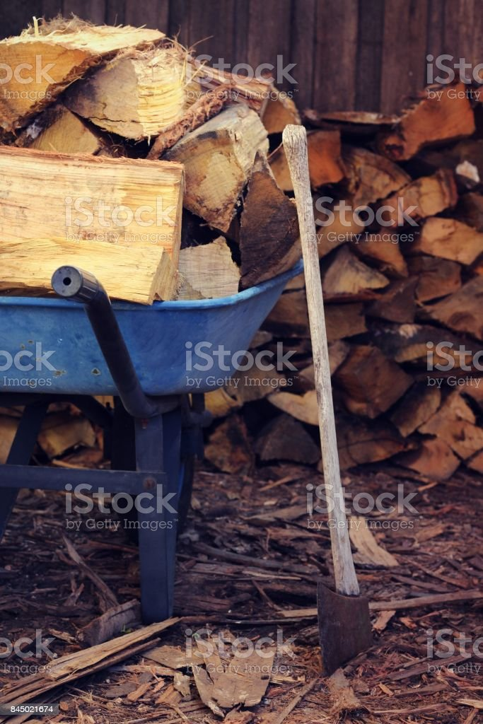 Wheelbarrow load of wood stock photo