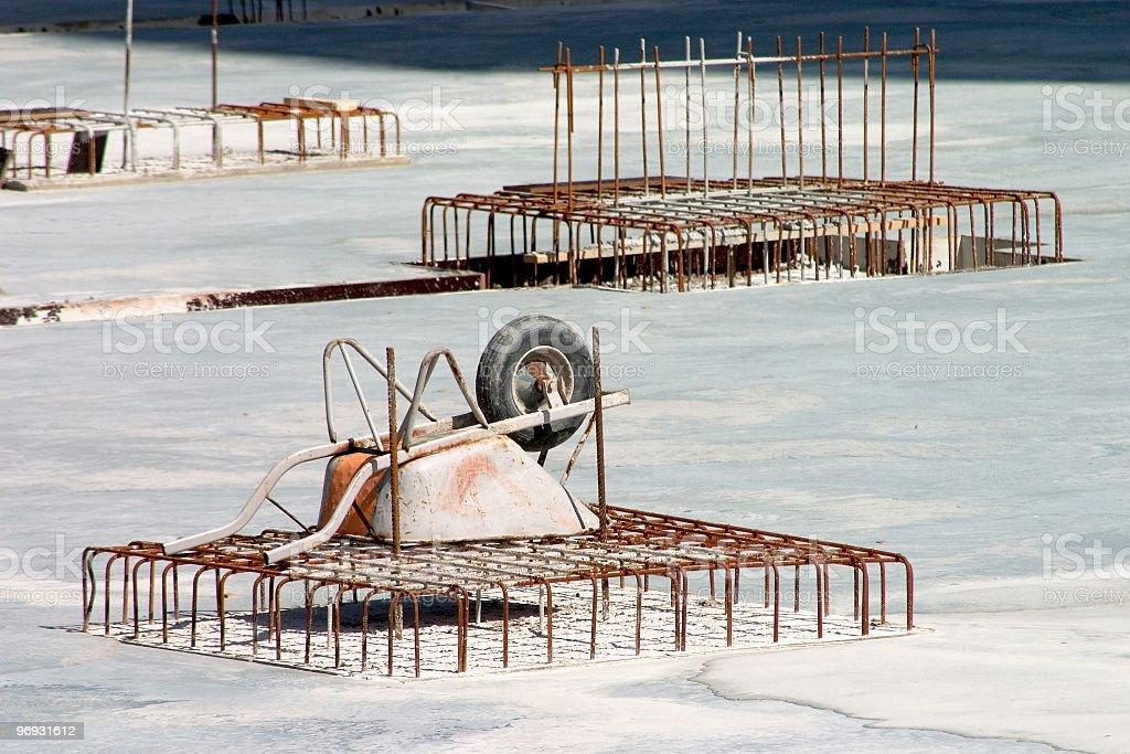 Wheelbarrow on rebar stock photo
