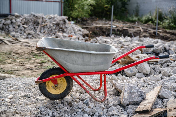 wheelbarrow on the background of construction debris stock photo