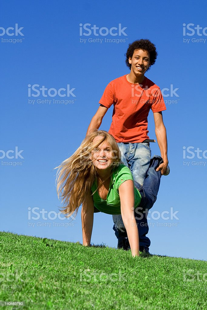 wheelbarrow race(SEE below for similar images) stock photo