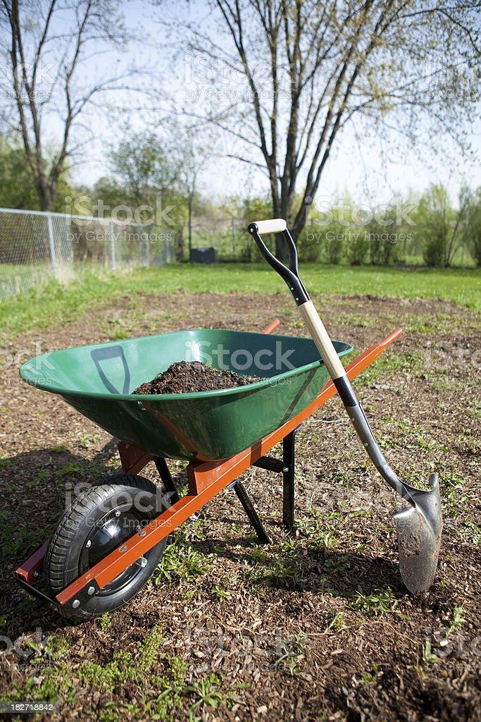 Wheelbarrow with Dirt and Shovel royalty-free stock photo