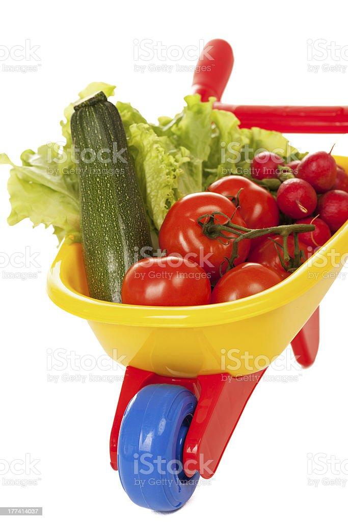 Wheelbarrow with vegetables stock photo