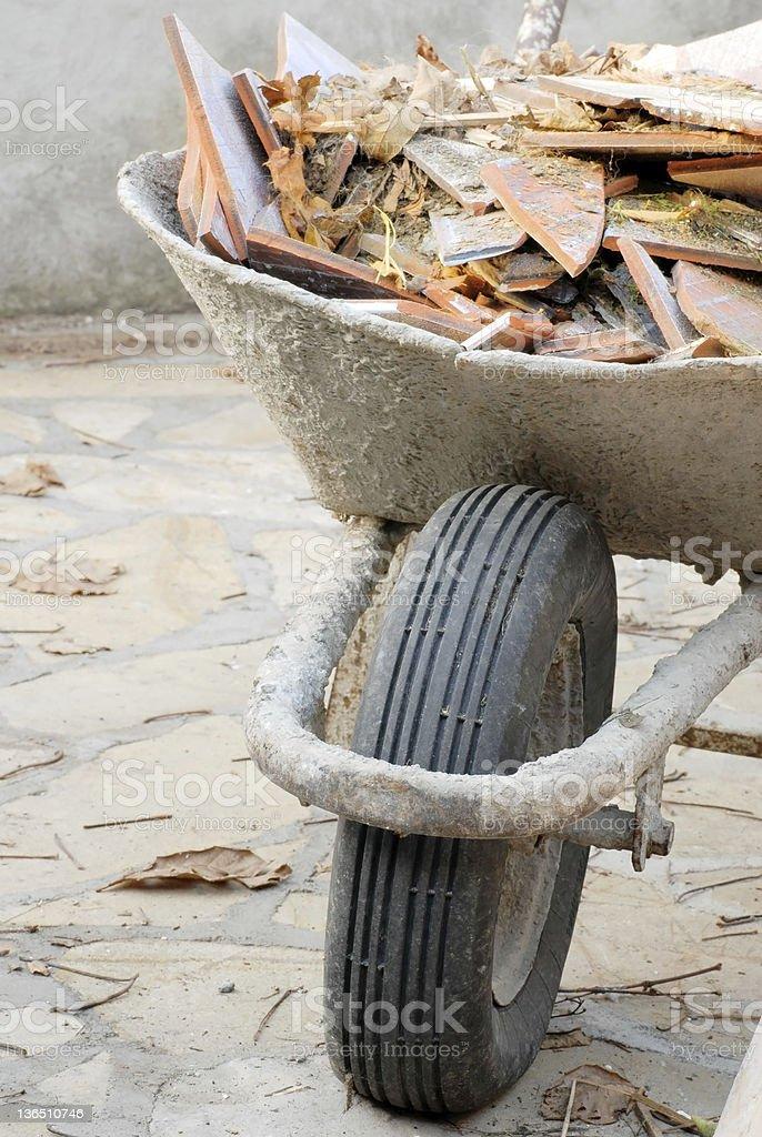 Wheelbarrow with waste royalty-free stock photo
