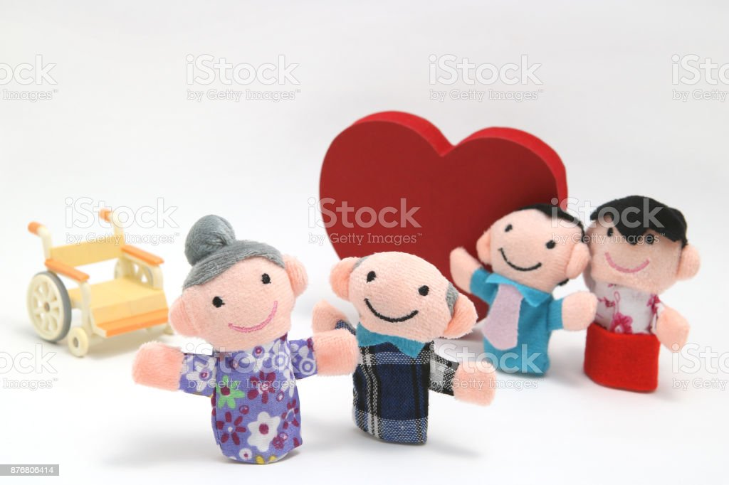 Wheelchair, a big red heart, and two-families on white background. stock photo
