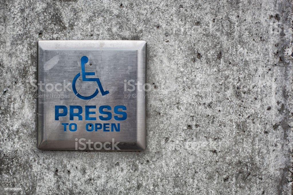 Wheelchair access button stock photo