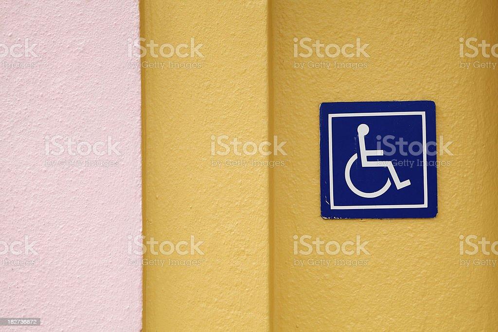 Wheelchair Accessible Sign, Art Deco Stucco Wall, ADA Icon stock photo