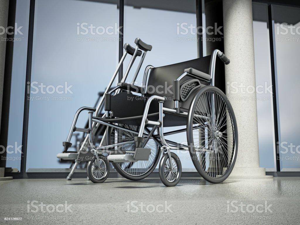 Rollstuhl und Krücken stehen vor Krankenhausgebäude – Foto