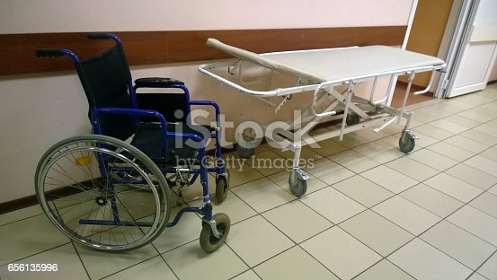 istock Wheelchair and medical bed in an old medical facility 656135996